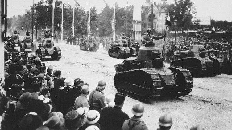 Défilé militaire à Paris, le 14 juillet 1919. (ANN RONAN PICTURE LIBRARY / AFP)