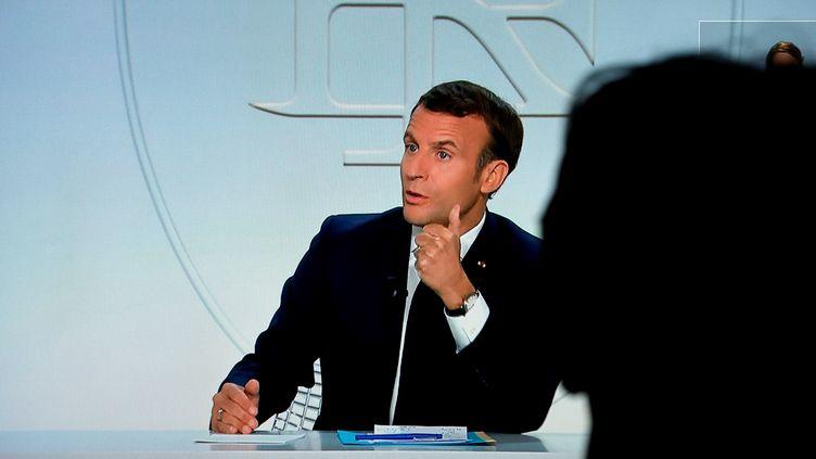 Emmanuel Macron lors d'une interview télévisée, le14 octobre 2020. (LUDOVIC MARIN / AFP)