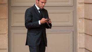 Emmanuel Macron, alors ministre de l'Economie, le 1er septembre 2014 à l'Elysée. (PHILIPPE WOJAZER / AFP)