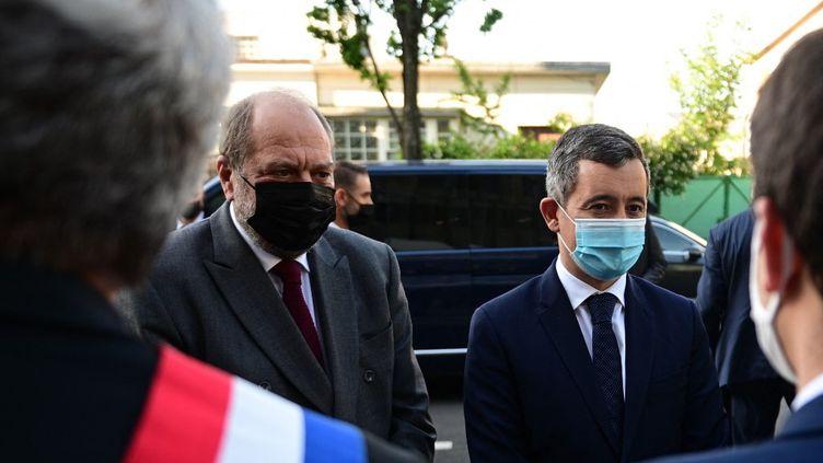 Eric Dupond-Morettiet Gérald Darmanin, à Saint-Denis, le 28 mai 2021. (MARTIN BUREAU / AFP)