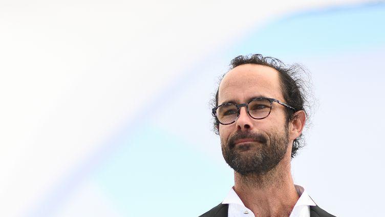 Le militant Cédric Herrou au festival de Cannes (Alpes-Maritimes), le 18 mai 2018. (ANNE-CHRISTINE POUJOULAT / AFP)
