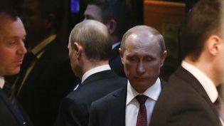 Vladimir Poutine à la sortie des négociations sur l'Ukraine, à Minsk (Biélorussie), jeudi 15 février 2015. (VASILY FEDOSENKO / REUTERS)