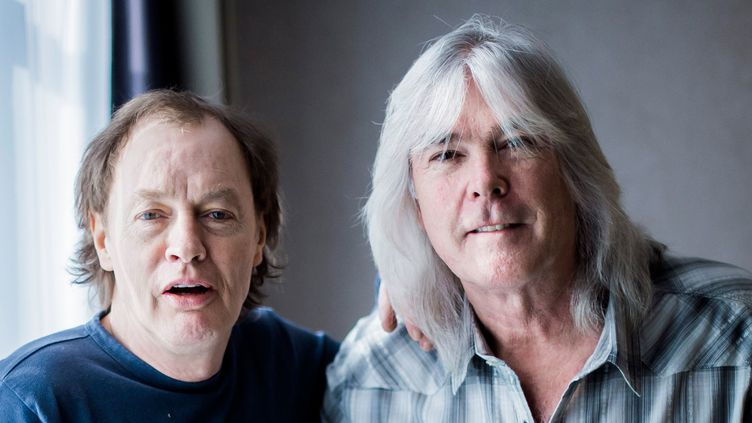 Angus Young et Cliff Williams de AC/DC en novembre 2014.  (Marcus Simaitis /DPA / AFP)