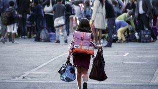 Une élève dans une école de Strasbourg (Bas-Rhin), le 2 septembre 2014. (FREDERICK FLORIN / AFP)