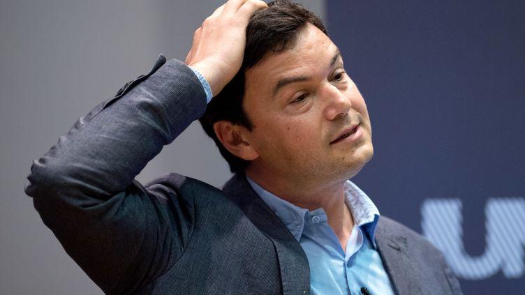 L'économiste français Thomas Piketty lors d'une présentation de son livre au King's College à Londres (Royaume-Uni), le 30 avril 2014. (LEON NEAL / AFP)