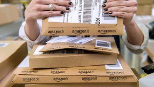 Pour l'instant, le textile est un tout petit marché pour le géant américain Amazon et ne représente qu'à peine7% des ventes. (PHILIPPE HUGUEN / AFP)