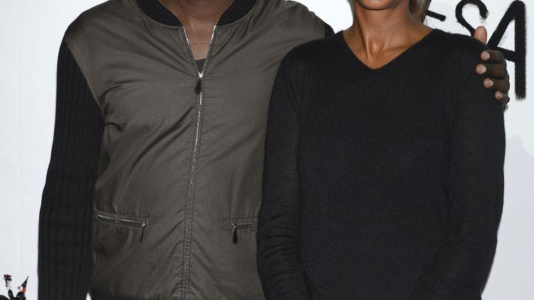 L'ex-footballeur Lilian Thuram et l'animatrice de télévision Karine Le Marchand lors de la 50e édition du Gala de l'union des artistes, à Paris, le 12 novembre 2012. (BERTRAND GUAY / AFP)