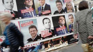 Des affiches des candidats à l'élection présidentielle, le 10 avril 2017 à Paris. (DENIS ALLARD / REA)