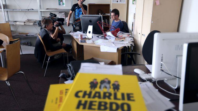"""Les locaux de l'hebdomadaire satirique """"Charlie Hebdo"""", à Paris, le 19 septembre 2012. (THOMAS SAMSON / AFP)"""