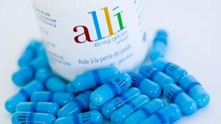 La pilule Alli était vendue en France sans ordonnance depuis 2009, par le laboratoire GlaxoSmithKline. (GARO / PHANIE / AFP)