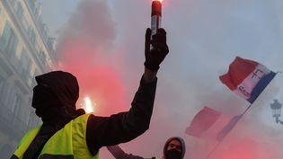 """Des """"gilets jaunes"""" dans le cortège de la manifestation organisée par la CGT à Paris, le 5 février 2019. (ALAIN JOCARD / AFP)"""
