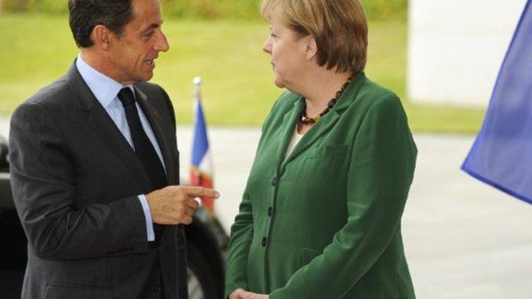 Angela Merkel et Nicolas Sarkozy, le 20 juillet 2011 à Berlin, avant une rencontre préparatoire au sommet le de l'euro. (AFP PHOTO / ODD ANDERSEN)