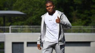 Kylian Mbappé arrive à Clairefontaine (Yvelines), le 28 août 2017. (FRANCK FIFE / AFP)