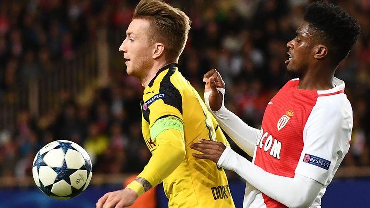 Marco Reus (Dortmund) face à Jemerson (Monaco) (BORIS HORVAT / AFP)