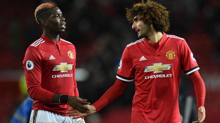 Les milieux de terrain de Manchester United, Paul Pogba et Marouane Fellaini.