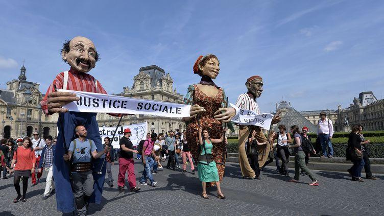 Le 16 juin 2014, lesintermittents du spectacle manifestent dans Paris. (MIGUEL MEDINA / AFP)