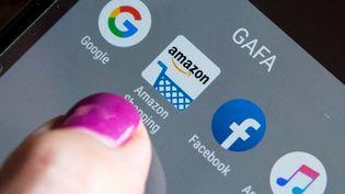 La taxe GAFA devrait s'appliquer à une trentaine de groupes, comme Meetic, Amazon, Airbnb, Instagram ou encore la française Criteo  (Riccardo Milani / Hans Lucas)