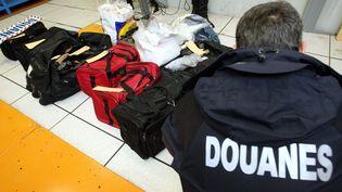 Une trentaine de kilos d'héroïne saisis en début de semaine au péage de Saint-Arnoult, dans les Yvelines. (DENIS CHARLET / AFP)
