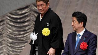 Le réalisateur japonais Takeshi Kitano, à l'occasion d'une cérémonie célébrant les 30 ans de règne de l'empereur Akihito, le 10 avril 2019. (TOSHIFUMI KITAMURA / AFP)