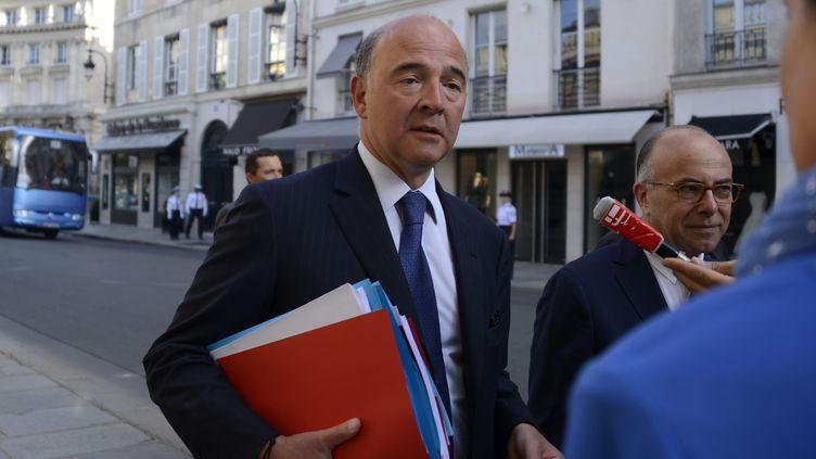 Le ministre de l'Economie et des Finances à son arrivée à l'Elysée, à Paris, le 19 août 2013, pour un séminaire gouvernemental. (BERTRAND GUAY / AFP)