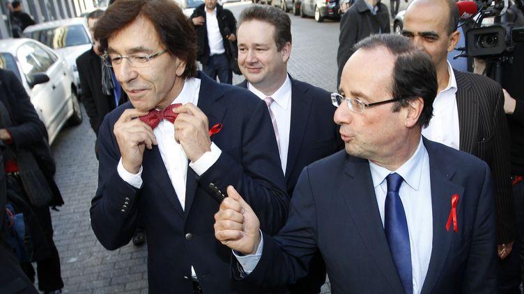 Le Premier ministre belge Elio di Rupo et François Hollande, le 30 novembre 2011 à Bruxelles. (FRANCOIS LENOIR / REUTERS)