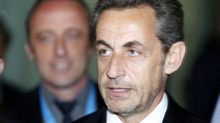 Nicolas Sarkozy lors de l'inauguration del'institut Claude-Pompidou consacré à la recherche sur la maladie d'Alzheimer, le 10 mars 2014 à Nice (Alpes-Maritimes). (VALERY HACHE / AFP)
