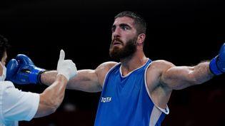 Mourad Aliev lors de son combat aux Jeux Olympiques de Tokyo 2021. (THEMBA HADEBE / POOL / AFP)