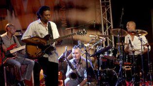 Hervé Samb (guitare), Olivier Temime (saxophone), Reggie Washington (basse) et Chander Sardjoe (batterie)sur la scène du New Morning le 26 septembre 2013  (photo by courtesy © Christian Ducasse)