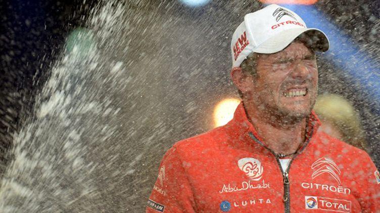 Loeb quitte les rallyes sous le champagne (PATRICK HERTZOG / AFP)