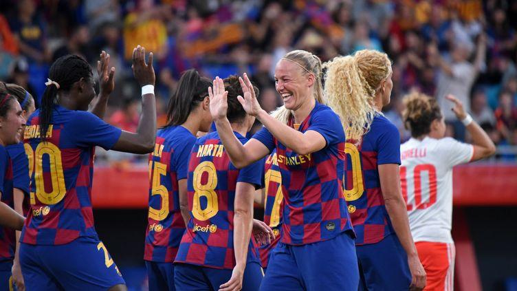 Des joueuses du FC Barcelone célèbrent un but durant un match de Ligue des champions contre la Juventus Turin, le 25 septembre 2019, en Espagne. (NOELIA DENIZ / NURPHOTO / AFP)