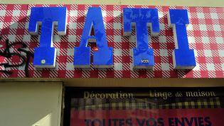 Enseigne du magasin Tati de Barbès à Paris, photographiée le 5 mai 2017.  (SERGE ATTAL / ONLY FRANCE / AFP)