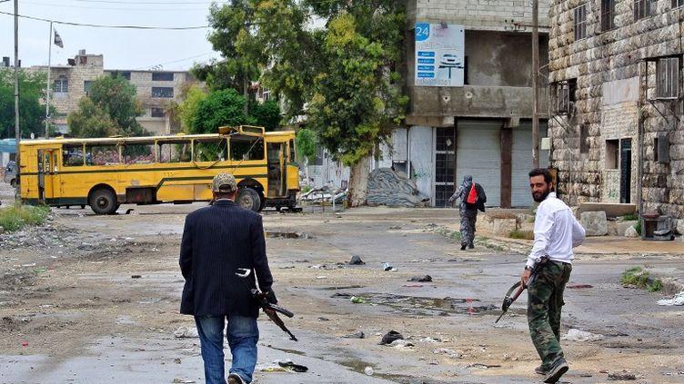 Des rebelles syriens dans la ville d'Alep (Syrie), en mai 2013. (AFP)