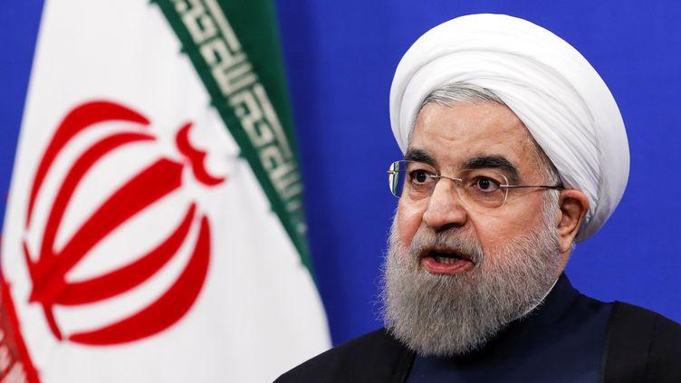 Le président iranien, Hassan Rohani, donne une conférence de presse à Téhéran (Iran) le 17 janvier 2017,pour célébrer lepremier anniversaire de l'accord sur le nucléaire iranien. (ATTA KENARE / AFP)