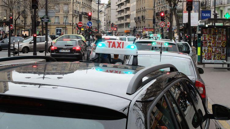 Manifestation des taxis dans les rues de Paris, le 13 janvier 2014 (WITT / SIPA)