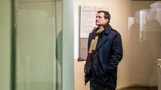 Le maire RN de Perpignan (Pyrénées-Orientales), dans un musée de la ville, le 9 février 2021. (JEAN-CHRISTOPHE MILHET / HANS LUCAS / AFP)