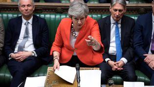 La Première ministre britannique, Theresa May, lors d'une session au Parlement sur le Brexit, le 12 mars 2018. (JESSICA TAYLOR / AFP)
