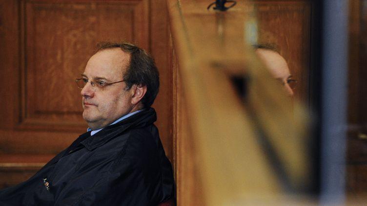 Le docteur Jean-Louis Muller, au début de son troisième procès, le 21 octobre 2013 à Nancy (Meurthe-et-Moselle). (JEAN-CHRISTOPHE VERHAEGEN / AFP)