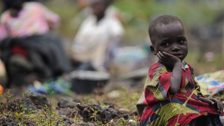 Enfant d'un groupe de réfugiés arrivé à Kibati le 25 juillet 2012. (AFP PHOTO / PHIL MOORE)