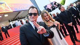 """Quentin Tarantino et Margot Robbie présentent""""Once Upon a Time... in Hollywood"""" dans la joie et la bonne humeur. (ALBERTO PIZZOLI / AFP)"""