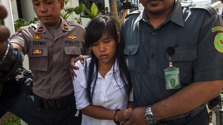Mary Jane Veloso, une Philippine de 30 ans condamnée à mort pour trafic de drogue, arrive au tribunal de Sleman, sur l'île de Java (Indonésie), le 3 mars 2015. (SURYO WIBOWO / AFP)