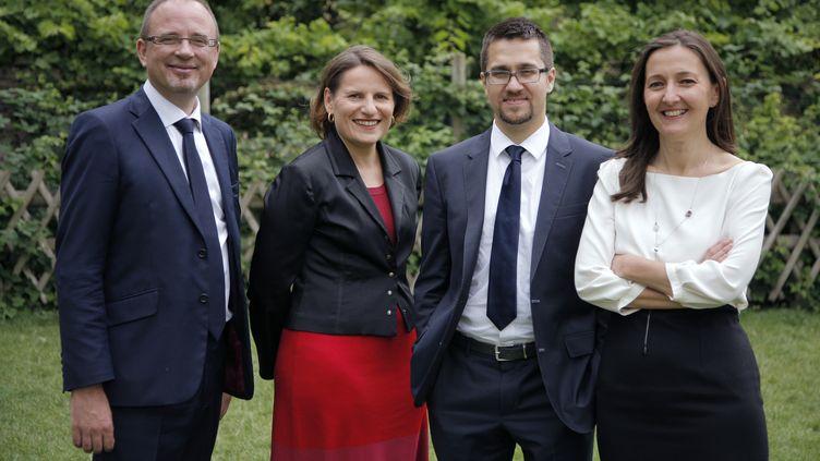 """Les députés socialistesYann Galut, Valérie Rabault, Alexis Bachelay et Karine Berger (de g. à d.), membres du collectif """"Cohérence socialiste"""",posent près de l'Assemblée nationale, le 7 juillet 2014. (MATTHIEU ALEXANDRE / AFP)"""