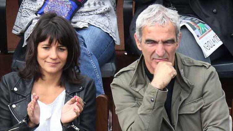 Raymond Domenech et sa compagne Estelle denis (KENZO TRIBOUILLARD / AFP)