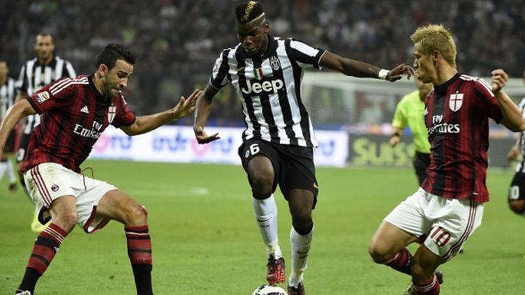 Pogba face à Rami (OLIVIER MORIN / AFP)