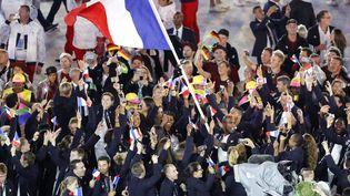 Teddy Riner avait porté le drapeau français lors de la cérémonie d'ouverture des Jeux de Rio, en août 2016. (THOMAS COEX / AFP)