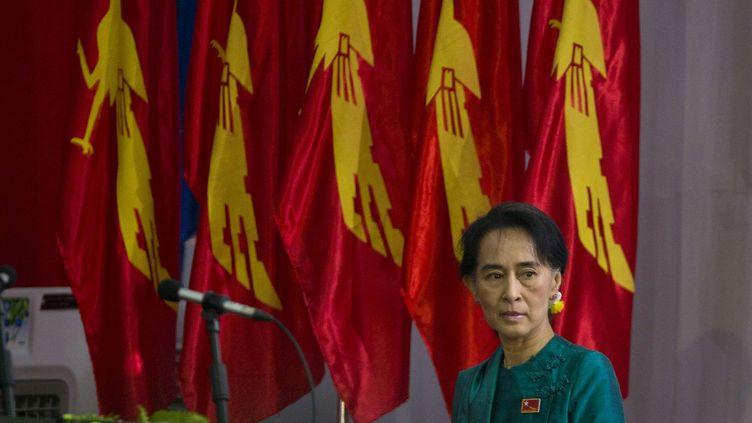 Aung San Suu Kyi au congrès du parti d'opposition qu'elle dirige,à Rangoon en Birmanie, le 9 mars 2013. (GEMUNU AMARASINGHE / SIPA )