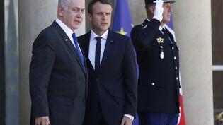 Le Premier ministre israélien Benyamin Nétanyahou avec Emmanuel Macron à l'Elysée, le 16 juillet 2017. (GEOFFROY VAN DER HASSELT / AFP)