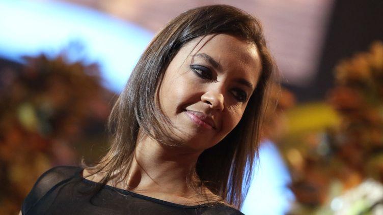 Karine Le Marchand participe à la soirée du Téléthon, le 7 décembre 2013 à Saint-Denis (Seine-Saint-Denis). (KENZO TRIBOUILLARD / AFP)