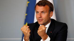 Emmanuel Macron lors d'une visioconférence internationale sur les vaccins contre le Covid-19, le 4 mai 2020, à Paris. (GONZALO FUENTES / POOL / AFP)