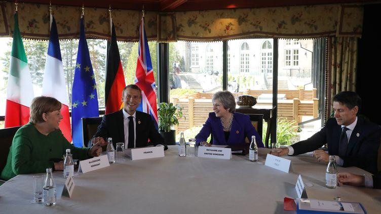 La chancelière allemande Angela Merkel, le président français Emmanuel Macron, la Première ministre britannique Theresa May et le Premier ministre italien Giuseppe Conte lors du sommet du G7 à La Malbaie au Canada, le 8 juin 2018. (LUDOVIC MARIN / POOL)