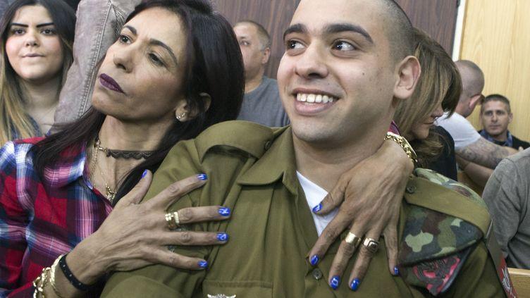 Le soldat israélien Elor Azaria lors de l'énoncé de sa condamnation par un tribunal militaire à Tel-Aviv (Israël), le 21 février 2017. (JIM HOLLANDER / AFP)
